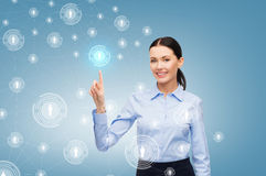 Smiling businesswoman pointing finger at you Royalty Free Stock Images