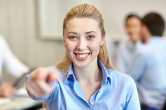 Smiling businesswoman pointing finger on you Royalty Free Stock Photography