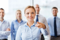 Smiling businesswoman pointing finger on you Royalty Free Stock Photo