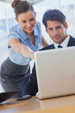 Smiling businesswoman pointing at the laptop Stock Photography