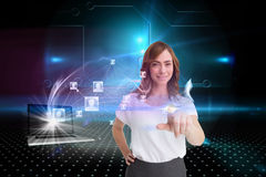 Smiling businesswoman pointing with laptop and profiles behind Stock Photography