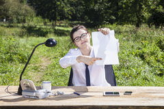 Smiling businesswoman pointing place on a piece of paper Stock Photography