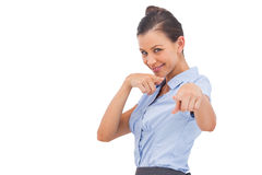 Smiling businesswoman pointing something with fingers Royalty Free Stock Photos