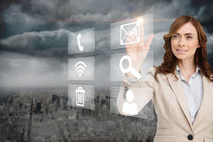 Smiling businesswoman pointing to email on app menu Stock Image