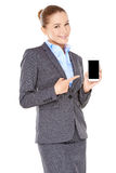 Smiling businesswoman pointing to her mobile Stock Image