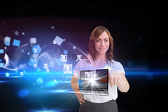 Smiling businesswoman pointing to laptop and profiles behind Stock Image