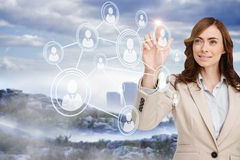Smiling businesswoman pointing to profile picture Royalty Free Stock Image