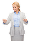 Smiling businesswoman pointing to something Stock Image