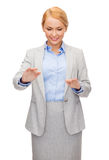 Smiling businesswoman pointing to something Stock Images