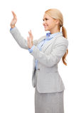 Smiling businesswoman pointing to something Stock Photos