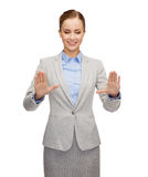 Smiling businesswoman pointing to something Stock Photography