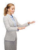 Smiling businesswoman pointing to something Stock Photo