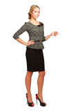 Smiling businesswoman pointing up, isolated on Royalty Free Stock Images