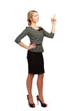 Smiling businesswoman pointing up, isolated on Stock Photography