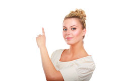 Smiling businesswoman pointing up, isolated on white background Royalty Free Stock Photo