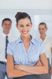Smiling businesswoman posing with arms crossed Stock Photo