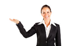 Smiling businesswoman presenting Stock Images