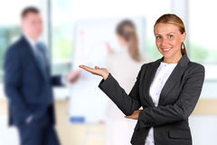 Smiling businesswoman presenting. Presentation on a background Royalty Free Stock Photo