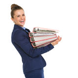 Smiling businesswoman in profile holding stack of files Stock Photography