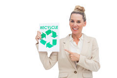 Smiling businesswoman promoting recycling and environment Stock Photography