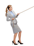 Smiling businesswoman pulling rope. Business and education concept - smiling businesswoman pulling rope Stock Photo
