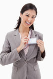 Smiling businesswoman putting on name badge Royalty Free Stock Photography