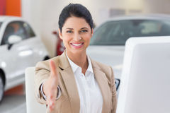 Smiling businesswoman reaching for handshake Royalty Free Stock Photos