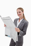 A smiling businesswoman reading the news Royalty Free Stock Photo