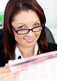 Smiling businesswoman reading a newspaper Stock Photo