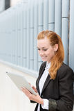 Smiling Businesswoman Reading Tablet PC Royalty Free Stock Images