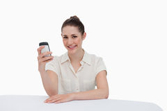 Smiling businesswoman reading a text message Stock Images
