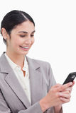 Smiling businesswoman reading text message Stock Images