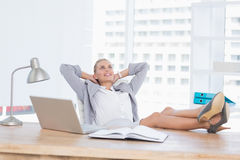 Smiling businesswoman relaxing on her office Royalty Free Stock Images
