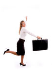 Smiling businesswoman running with briefcase Royalty Free Stock Photos