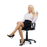 Smiling businesswoman or secretary in office Royalty Free Stock Photo