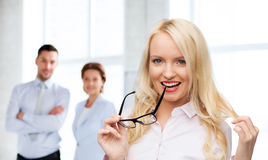 Smiling businesswoman or secretary in office Royalty Free Stock Photography