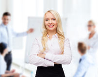 Smiling businesswoman or secretary in office Stock Photography