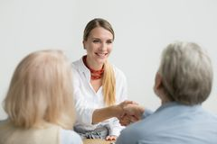 Smiling businesswoman shaking hand of senior hr at job interview. Smiling confident businesswoman applicant shaking hand of senior hr manager making good first Royalty Free Stock Photography