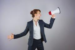 Smiling businesswoman shouting through megaphone Royalty Free Stock Photos