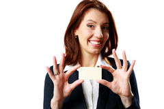 Smiling businesswoman showing blank business card Stock Images