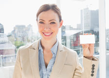 Smiling businesswoman showing blank business card Royalty Free Stock Photo