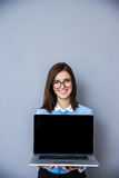 Smiling businesswoman showing blank laptop display Stock Photography