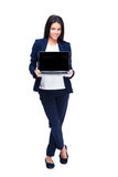Smiling businesswoman showing blank laptop screen Royalty Free Stock Photography