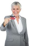 Smiling businesswoman showing her credit card Royalty Free Stock Image