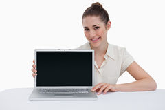 Smiling businesswoman showing a laptop Stock Photo