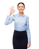 Smiling businesswoman showing ok sign Royalty Free Stock Images