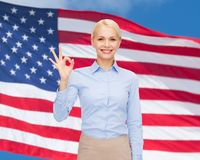 Smiling businesswoman showing ok-sign with hand Stock Photography