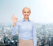 Smiling businesswoman showing ok-sign with hand Royalty Free Stock Photo