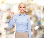 Smiling businesswoman showing ok-sign with hand Stock Images