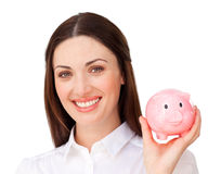 Smiling businesswoman showing a piggybank Royalty Free Stock Image